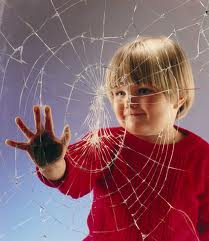 child pushing on cracked tempered window film